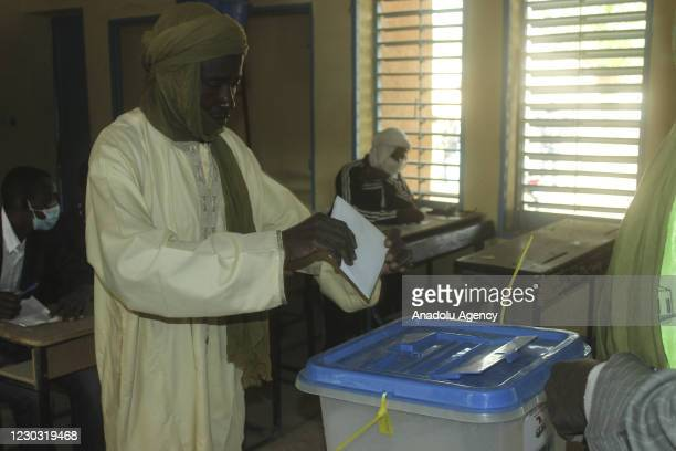 Nigerien casts his vote at the Lobbit School as voting for presidential and parliamentary elections is underway in Maradi, Niger on December 27, 2020.