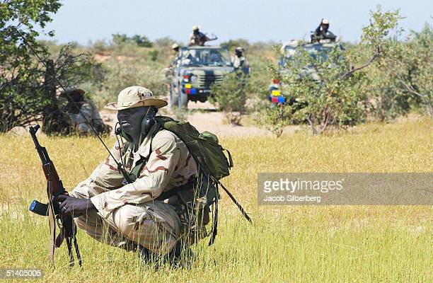 Nigerien soldier wearing a United States military uniform waits during a training exercise September 22 2004 in Samara Niger Through the TransSahara...