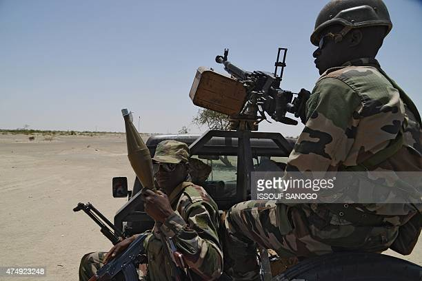 Nigerien soldiers patrol along the Nigerian border near the southeastern city of Bosso on May 25 2015 Niger has extended for three months the state...