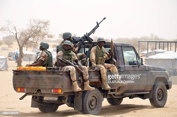 Nigerien soldiers patrol in a truck at Kabalewa Refugees Camp where Nigerians fleeing from Boko Haram Islamists attacks are sheltered at Diffa in...