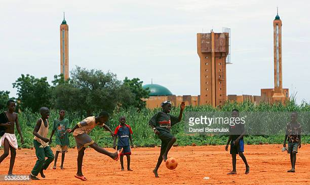 Nigerois boys play a game of soccer on August 12 2005 in Niamey Nigeria Niamey is the Capital of Niger Niger is experiencing a food crisis which is...