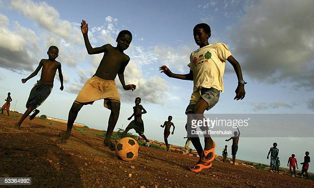 Nigerois boys play a game of soccer on August 12 2005 Niamey Nigeria Niamey is the Capital of Niger Niger is experiencing a food crisis which is...