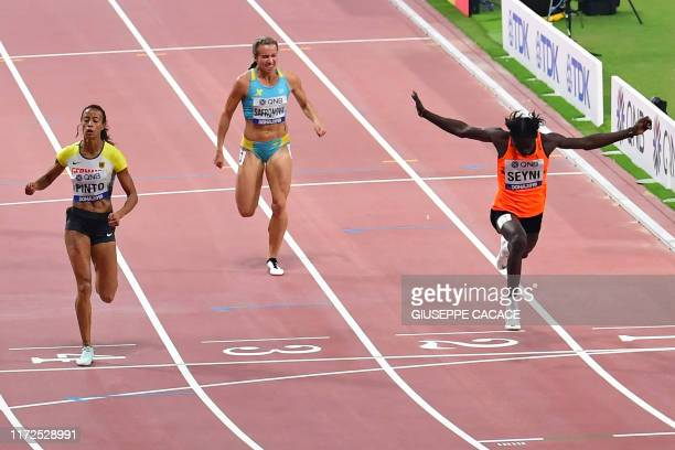 Niger's Aminatou Seyni leads Kazakhstan's Olga Safronova and Germany's Tatjana Pinto as she crosses the finish line in the Women's 200m heats at the...