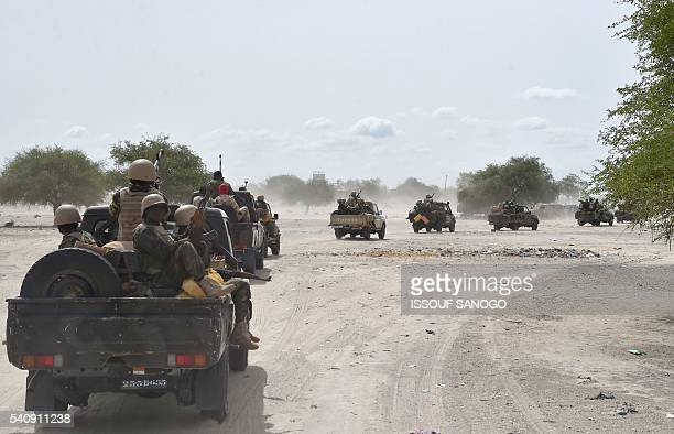 Niger's army convoy arrives in the city of Bosso on June 17 2016 following attacks by Boko Haram fighters in the region Boko Haram on June 9 attacked...