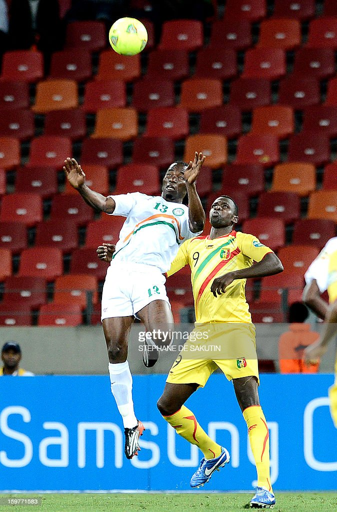 Niger's defender Mohamed Chicoto (L) fights for the ball with Mali's forward Cheick Tidiane Diabate during their 2013 Africa Cup of Nations football match at Nelson Mandela Bay Stadium in Port Elizabeth on January 20, 2013.
