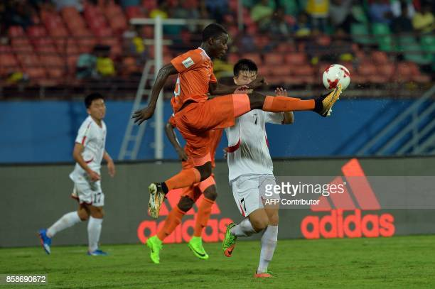Niger's Farouk Idrissa and North Korea's Kim Hwi Hwang fight for the ball during the group stage football match between North Korea and Niger in the...