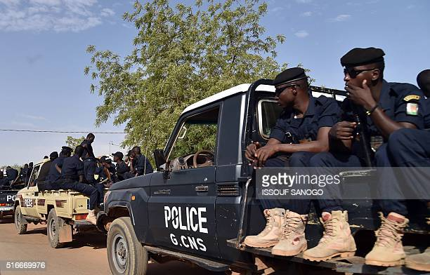 Niger's police patrols in street in Niamey on March 20 2016 during the second round of the presidential election Voters in Niger cast ballots in the...