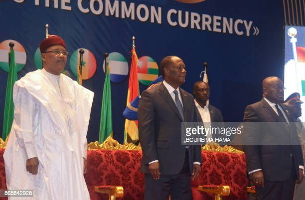 Niger's President Mahamadou Issoufou Ivory Coast President Alassane Ouattara and Ghana's President Nana Akufo Ado attend the opening of a summit of...