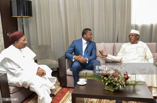 Niger's President Mahamadou Issoufou Togo's President Faure Gnassingbe and Chad's President Idriss Deby meet before the opening ceremony of a Heads...