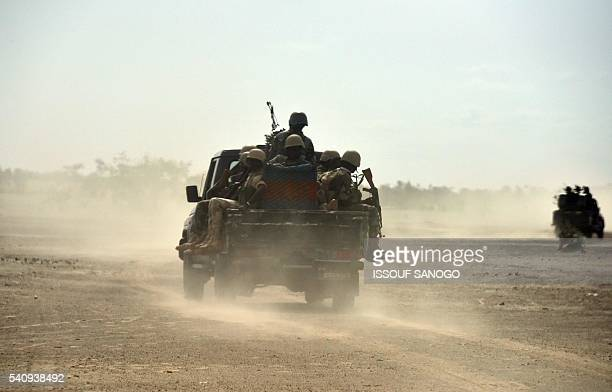 Niger's soldiers patrol near Bosso on June 17 2016 following attacks by Boko Haram fighters in the region Boko Haram on June 9 attacked a military...