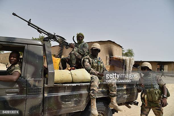 Niger's soldiers stand at Bosso military camp on June 17 2016 following attacks by Boko Haram fighters in the region Boko Haram on June 9 attacked a...