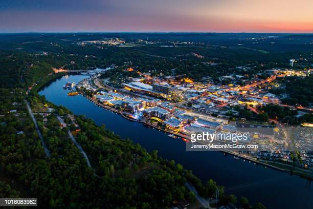 night aerial view of downtown branson, missouri and lake tanycomo - ozark mountains stock pictures, royalty-free photos & images