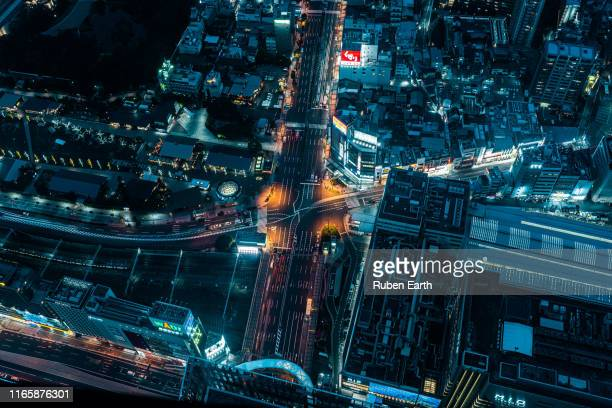 night aerial view of the city - futurism stock photos and pictures