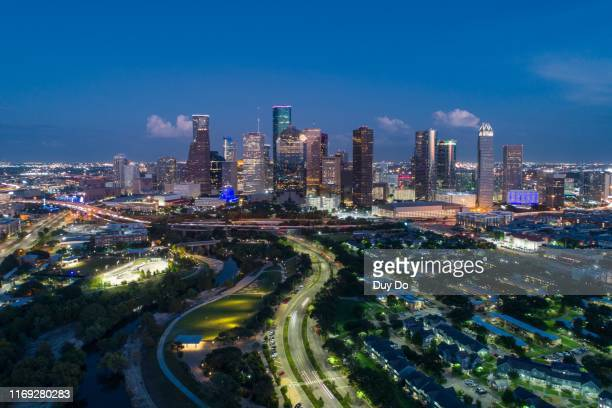 night aerial view taking by drone of skyline downtown houston , texas in the evening - houston stock pictures, royalty-free photos & images
