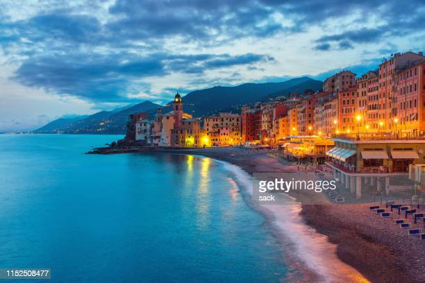 night arrives at camogli - genoa italy stock pictures, royalty-free photos & images