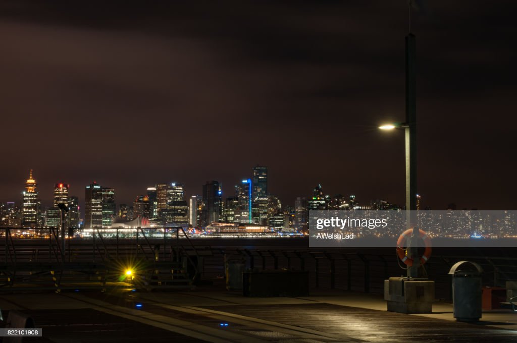 Night at Burrard Dry Dock Pier with downtown Vancouver, BC evening : Stock Photo