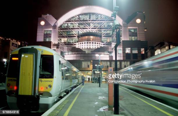 Night at Charing Cross Station London and a South Eastern Trains Class 375 Electrostar awaits to depart whilst a Class 466 speeds away
