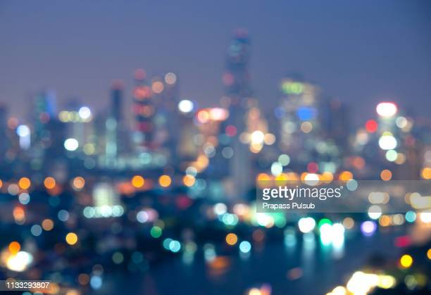 night blurred bokeh light city office building, abstract background - デフォーカス ストックフォトと画像