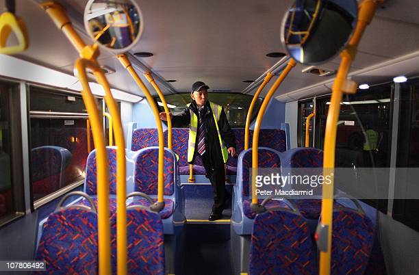 Night bus driver Chitpinit Kaewchaluay checks his bus at Cricklewood Bus Depot on December 15 2010 in London England Chitpinit will drive the night...