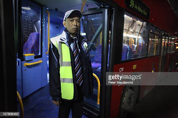 Night bus driver Chitpinit Kaewchaluay stands in his bus at Cricklewood Bus Depot on December 15 2010 in London England Chitpinit will drive the...