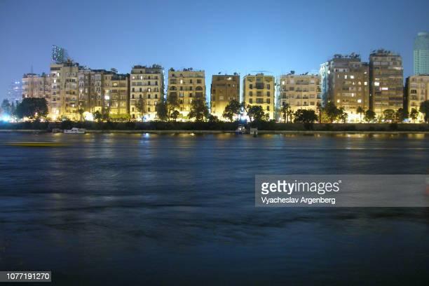 night cairo and river nile, zamalek city lights, egypt - zamalek photos et images de collection