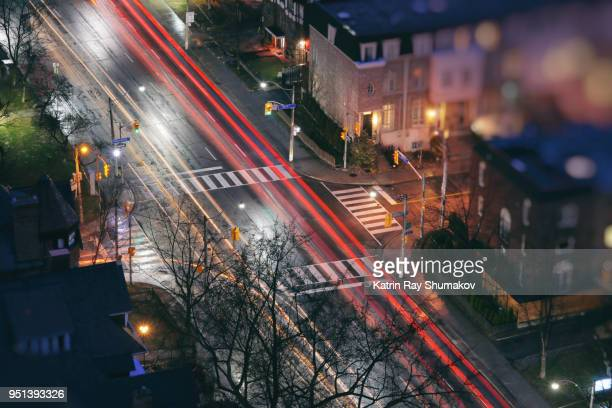 night city road with zooming cars - ontario canada stock photos and pictures
