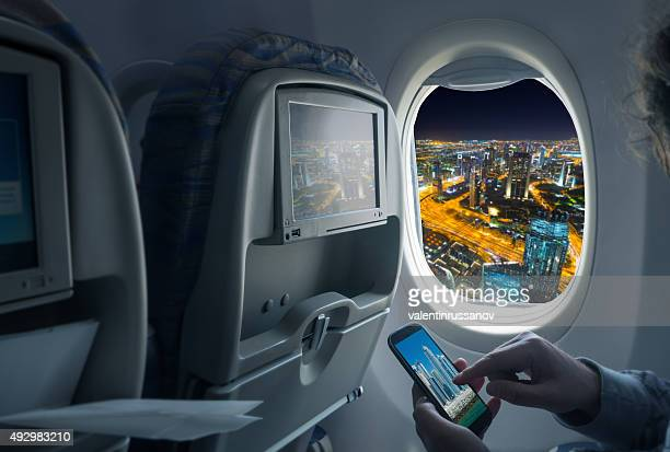 night cityscape from an airplane - aircraft stock photos and pictures