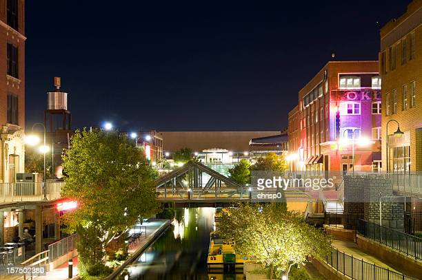 night cityscape view of bricktown in oklahoma city - oklahoma city stock pictures, royalty-free photos & images
