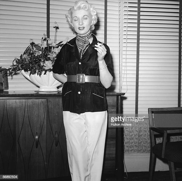Night club manageress Ruth Ellis poses for one Captain Ritchie 1954 The setting is probably the flat above her club on the Brompton Road in...