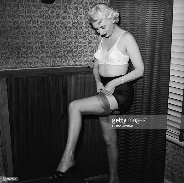 Night club manageress Ruth Ellis poses in her underwear for one Captain Ritchie 1954 The setting is probably the flat above her club on the Brompton...