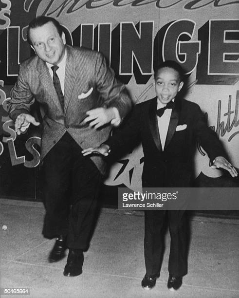 Night club owner Jack Ruby dancing w young boy who is wearing tuxedo during vaudeville act Ruby killed Pres Kennedy's assassin Lee Harvey Oswald