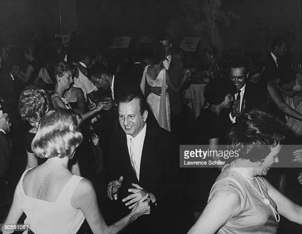 Night club owner Jack Ruby hoofing on dance floor w unident woman surrounded by others Ruby killed Pres Kennedy's assassin Lee Harvey Oswald