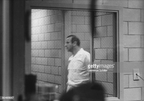 Night club owner Jack Ruby seen through window inside jail shortly after he was arrested for killing Lee Harvey Oswald alleged assassin of Pres John...