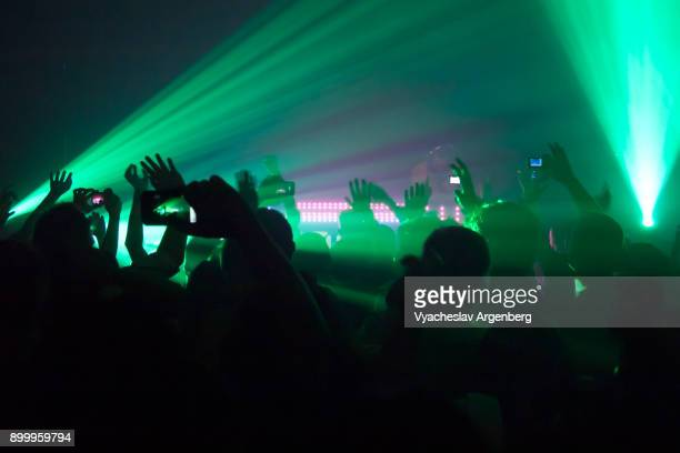 night clubbing in bangkok, lights and sounds of modern trance music - argenberg stock pictures, royalty-free photos & images