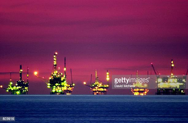 Night comes to oil and gas platforms near the Federal Ecological Reserve in the Santa Barbara Channel, February 15 near Santa Barbara, CA. In recent...