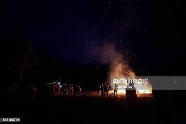 Night dancing around bon fire at rave