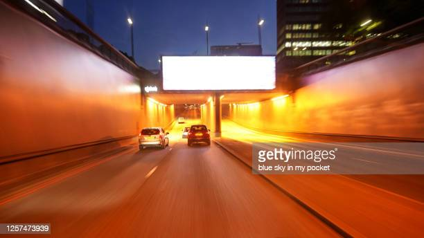 night driving blur - billboard highway stock pictures, royalty-free photos & images