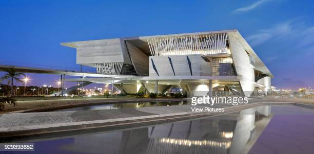 Night elevation across manmade pond La Cidade das Artes Barra da Tijuca Brazil Architect Christian de Portzamparc 2014