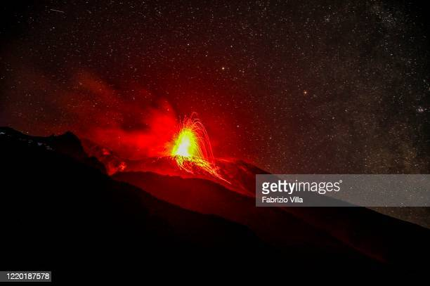 Night eruption of the volcano with explosions of lava and magma fountains on October 02 2019 in Stromboli Italy