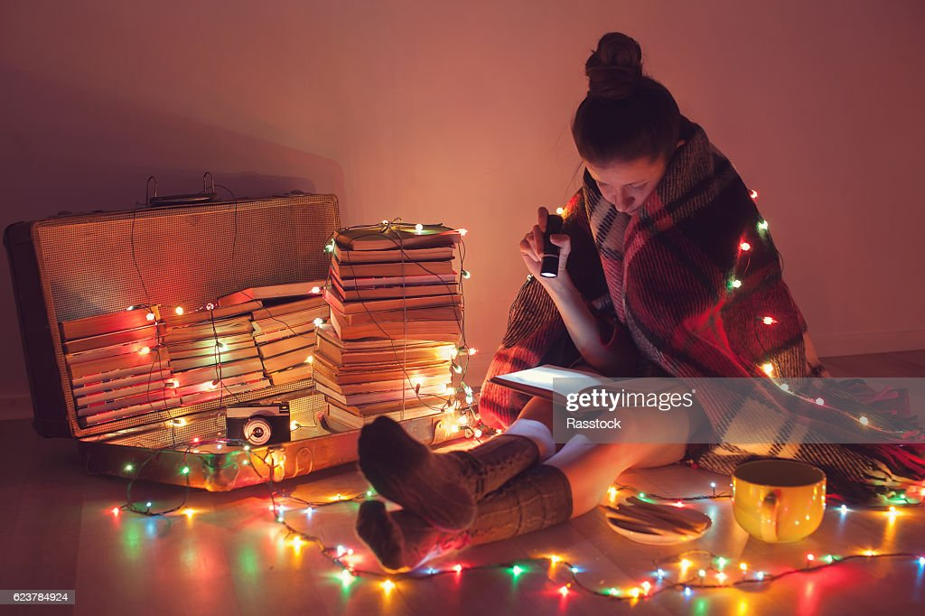 Night exciting reading with christmas lights : Stock Photo