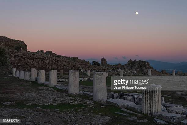 night falling over the ruins of the sanctuary of athena in pergamom, bergama, izmir province, aegean turkey - ancient civilization stock pictures, royalty-free photos & images
