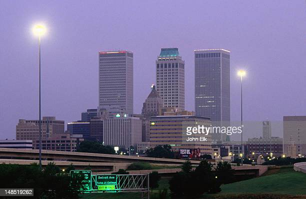 night falls on city skyline. - tulsa stock pictures, royalty-free photos & images