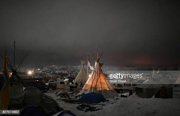 Night falls on Oceti Sakowin Camp on the edge of the Standing Rock Sioux Reservation on December 1 2016 outside Cannon Ball North Dakota Native...