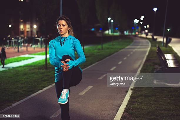 night female runner - warming up stock pictures, royalty-free photos & images