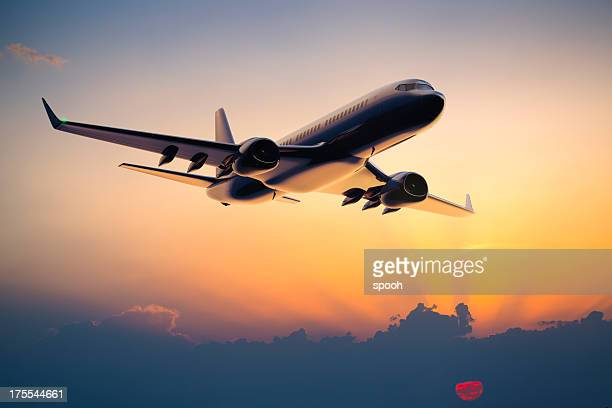 night flight of a passenger jet airplane - aircraft stock photos and pictures