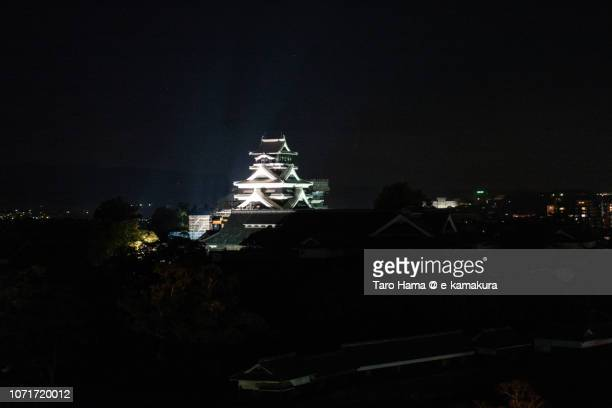 Night illuminated Kumamoto Castle in Kumamoto city in Japan
