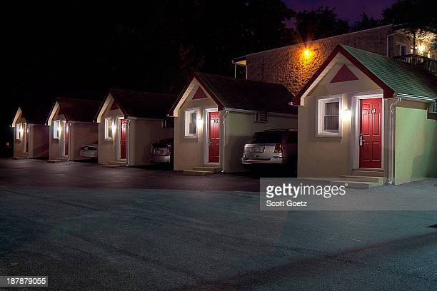 CONTENT] night image of 5 tiny oneroom motel bungalows