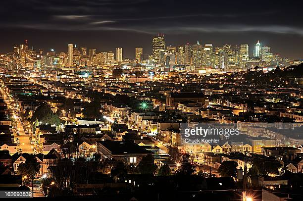 Night Image of the San Francisco Skyline from across the Pacific Heights neighborhood. Wispy clouds and thousands of neighborhood lights make this a...