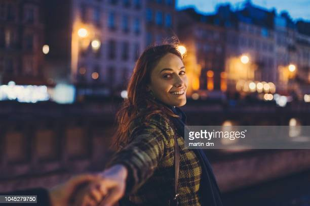 night in paris - following moving activity stock pictures, royalty-free photos & images