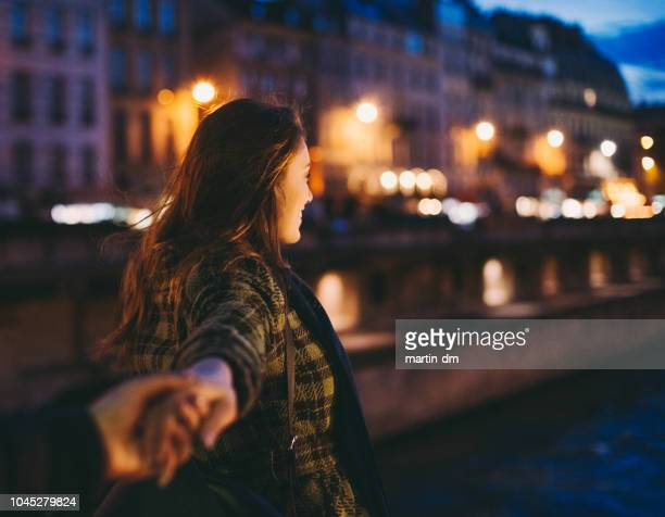 night in paris - following stock pictures, royalty-free photos & images